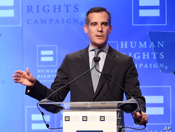 """FILE - Los Angeles Mayor Eric Garcetti, shown delivering a speech in his city in March 2016, says President-elect Donald Trump has been """"very supportive of our efforts to invest in infrastructure."""""""