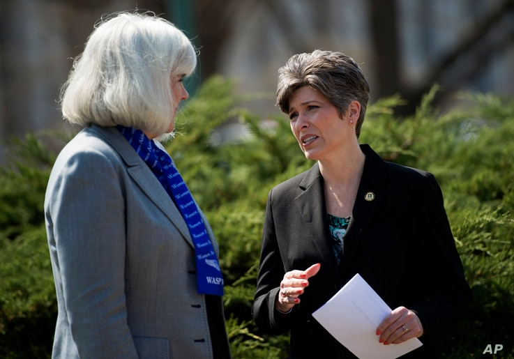 Sen. Joni Ernst, R-Iowa, right, speaks with Terry Harmon, daughter of WWII veteran WASP Elaine Harmon, left, before an event on the reinstatement of WWII female pilots at Arlington National Cemetery, on Capitol Hill in Washington, March 16, 2016.