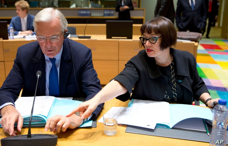 European Union chief Brexit negotiator Michel Barnier, left, speaks with EU Deputy Chief Negotiator Sabine Weyand during a meeting of EU General Affairs, Article 50, ministers in Brussels on Sept. 25, 2017.