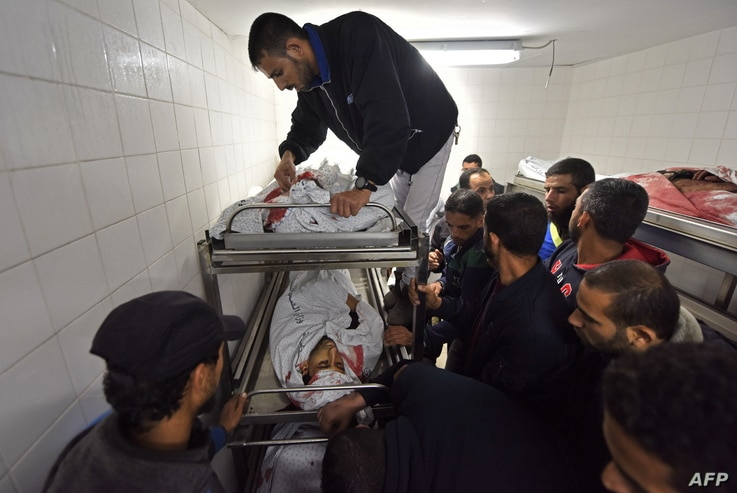 Palestinians gather at a hospital morgue in Khan Younis where the bodies of four of the six men killed during an Israeli raid on the city have been transported, Nov. 11, 2018.