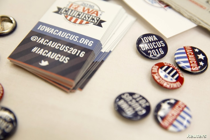 FILE - Buttons for visitors at the Greater Des Moines Partnership Iowa Caucus Consortium candidate forum are seen before a visit by U.S. Republican presidential candidate Jeb Bush in Des Moines, Iowa, Oct. 8, 2015.