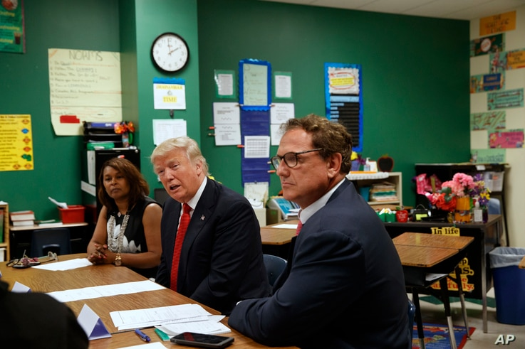 Republican presidential candidate Donald Trump meets with students and educators before speaking about school choice at the Cleveland Arts and Social Sciences Academy in Cleveland, Sept. 8, 2016.