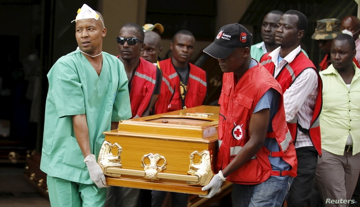 Mortuary workers and Kenya Red Cross volunteers carry the coffin containing the body of Mildred Yondo, a student killed during an attack by gunmen at Garissa University, from the Chiromo Mortuary in the capital Nairobi, Kenya, April 8, 2015.