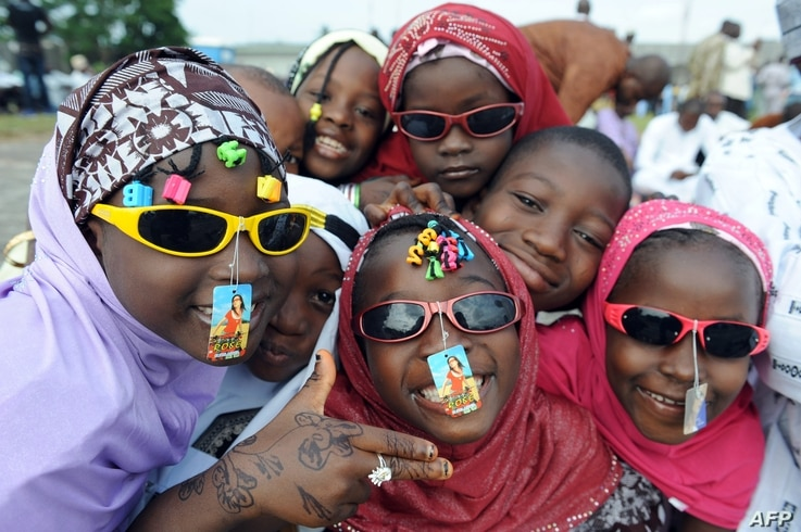 Children pose at Obalende praying ground in Lagos as muslims pray on the first day of Eid al-Fitr, August 19, 2012.