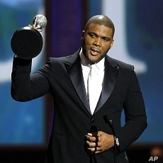 Perry accepts the Chairman's award at the 41st Annual NAACP Image Awards at the Shrine auditorium in Los Angeles, February 27, 2011