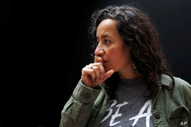 Ana Maria Archila, of New York City, co-executive director of the Center for Popular Democracy, pauses while being interviewed in Washington, Sept. 28, 2018, on Capitol Hill in Washington. Archila confronted Sen. Jeff Flake, R-Ariz., in an elevator a...