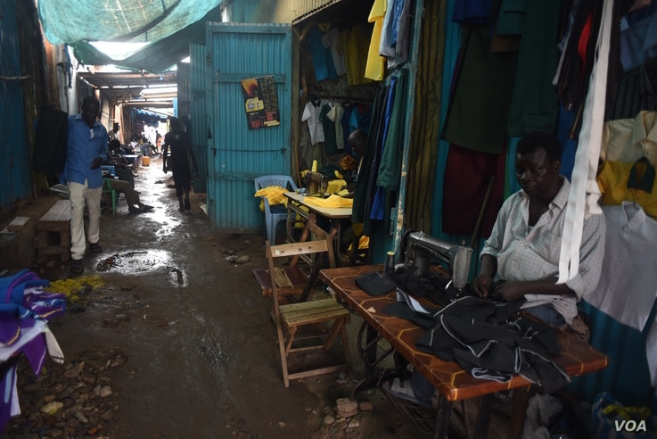 A tailor works in the bustling Konyo Konyo market in Juba, South Sudan, on April 15, 2016. (J. Patinkin/VOA)