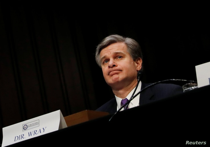 Federal Bureau of Investigation (FBI) Director Christopher Wray testifies before a Senate Intelligence Committee hearing on Capitol Hill in Washington, Feb. 13, 2018.