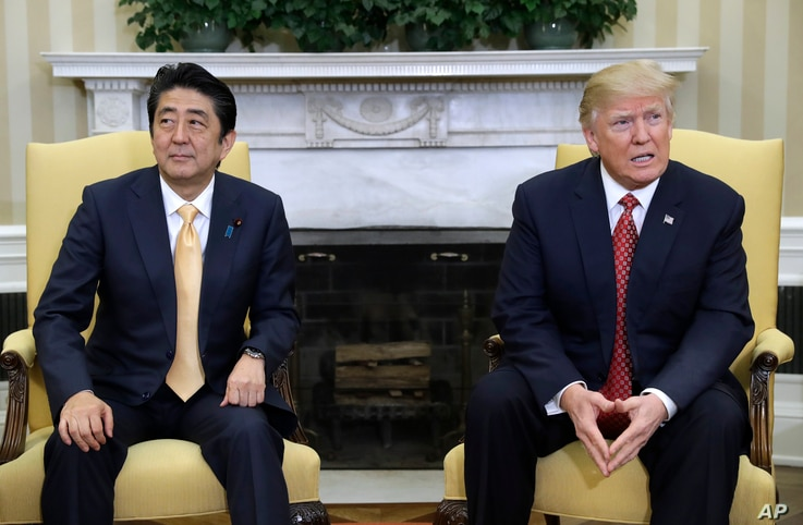 President Donald Trump meets with Japanese Prime Minister Shinzo Abe in the Oval Office of the White House in Washington, Feb. 10, 2017.