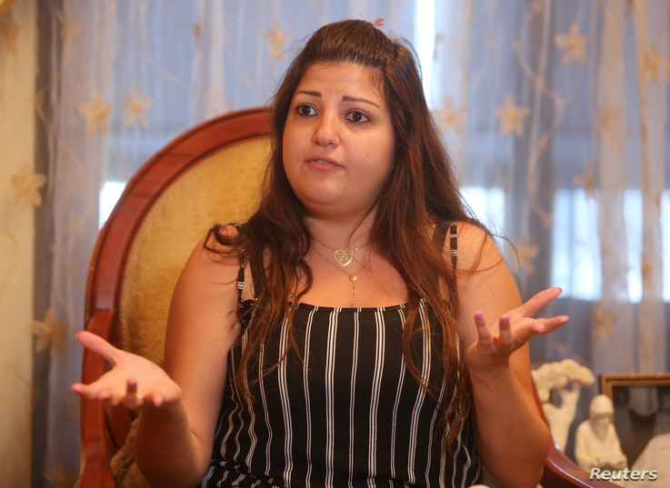 Jessy Kojababian gestures as she speaks during an interview with Reuters in Antelias, north of Beirut, Lebanon Aug. 7, 2018.