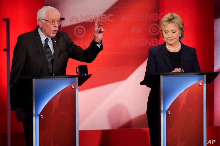 Democratic presidential candidate Senator Bernie Sanders makes a point as rival candidate Hillary Clinton listens during a presidential primary debate hosted by MSNBC in Durham, N.H., Feb. 4, 2016.
