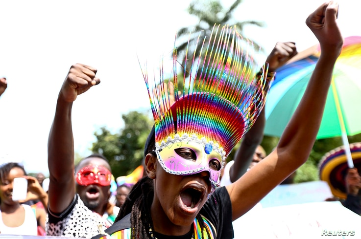 People walk in a parade as they celebrate the annulment of an anti-homosexuality law by Uganda's constitutional court in Entebbe, Uganda, Aug. 9, 2014.