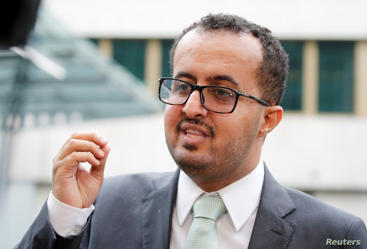 Hamza al-Kamali, member of the delegation of the government of Yemen, talks to reporters outside a hotel in Geneva, Sept. 6, 2018.