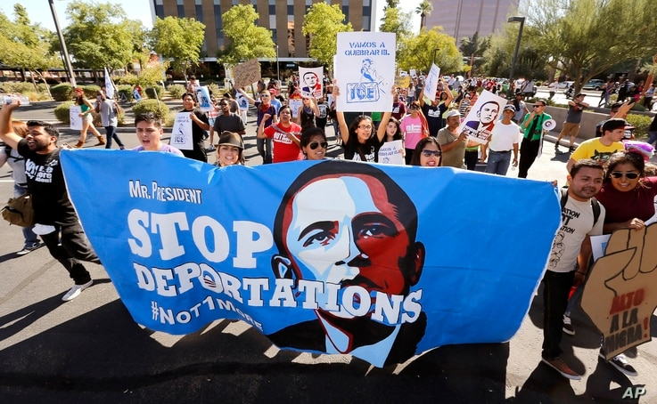 FILE - Upset with President Barack Obama's immigration policy, about 250 people march to the U.S. Immigrations and Customs Enforcement office with a goal of stopping future deportations in Phoenix, Arizona.