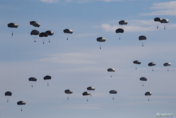 U.S. Paratroopers from the 82nd Airborne Division based in Fort Brag, N.C. , participate in a massive airdrop from C-17 Globemaster aircraft as part of the NATO Exercise Trident Juncture 2015 military exercise, NATO's largest  joint and combined mili...
