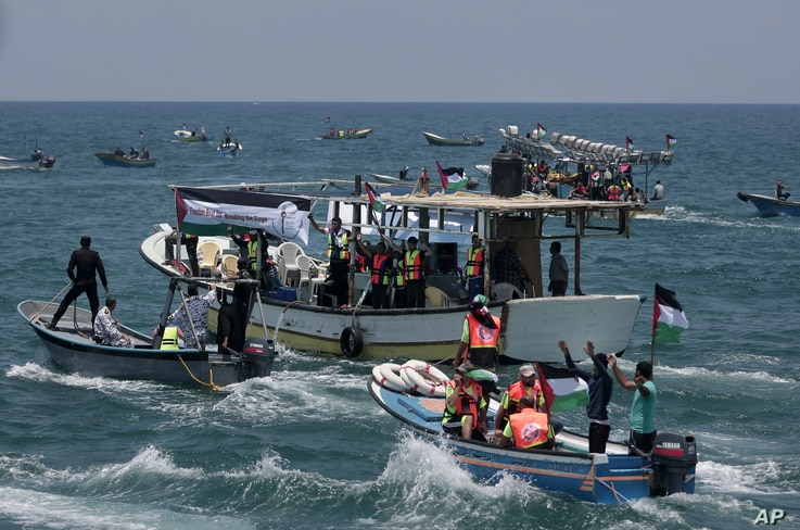 Two Palestinian fishing boats sail carrying 20 people including medical patients and students unable to leave through overland crossings, in Gaza City, May 29, 2018.