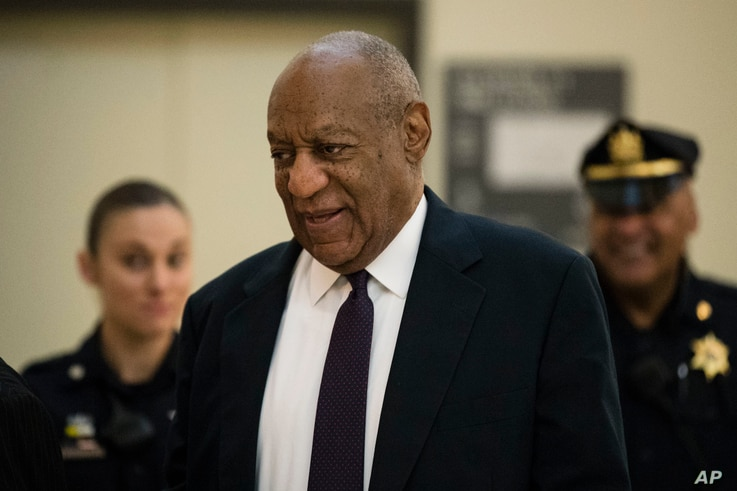Bill Cosby walks to the courtroom during his sexual assault trial at the Montgomery County Courthouse in Norristown, Pa., June 6, 2017.