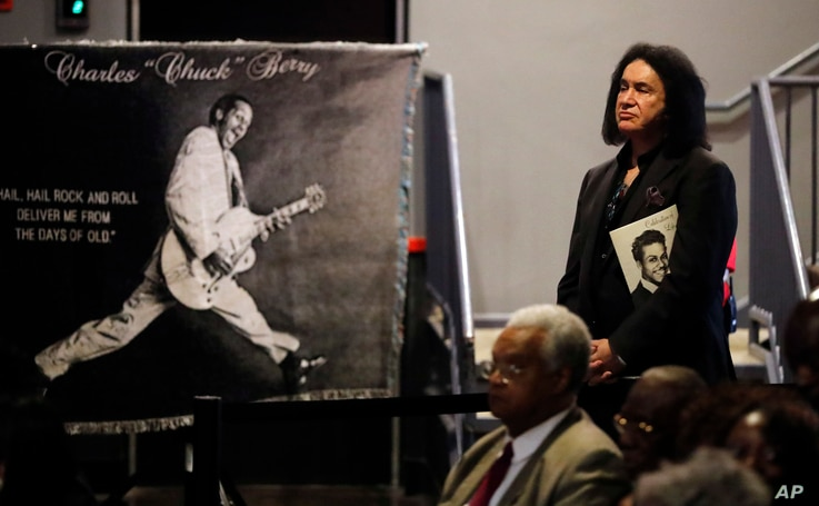 Gene Simmons, co-founder of the rock band Kiss, watches from the back of the room during a celebration of life for rock 'n' roll legend Chuck Berry, April 9, 2017, in St. Louis.