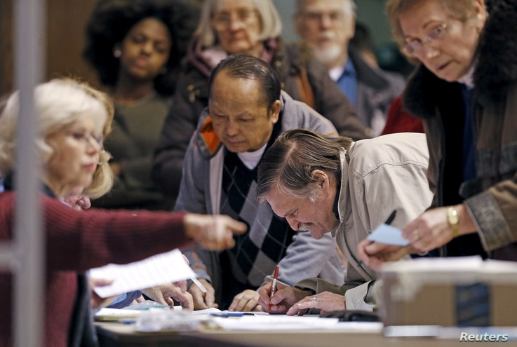 FILE - Precinct 5 Democratic Farm Labor Party voters register to take part in Super Tuesday caucusing for delegates at the Folwell Community Center Democratic caucus location in Minneapolis, Minnesota, March 1, 2016.