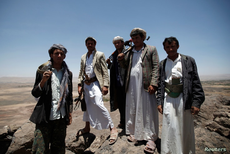 FILE - Pro-government tribesmen stand on a mountain where they are positioned to guard their area amid tension with militants of the Shiite Houthi group near Amran city, the capital of Amran province, north of the Yemeni capital Sanaa April 12, 2014....
