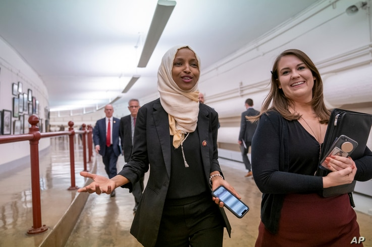 Rep. Ilhan Omar, D-Minn., walks to the chamber, March 7, 2019, on Capitol Hill in Washington.