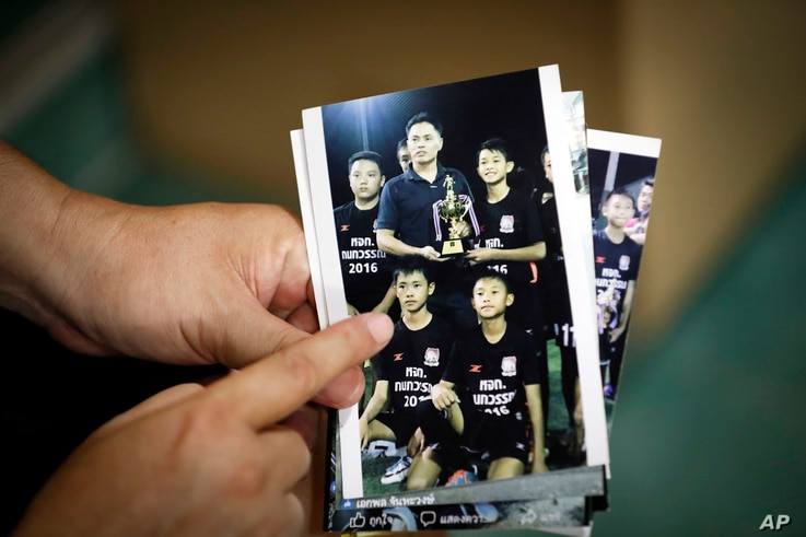 Banphot Konkum, father of Duangpetch Promthep, one of the rescued Thai boys, shows a picture of his son during an interview at their home in Mae Sai district, Chiang Rai province, northern Thailand, July 13, 2018.