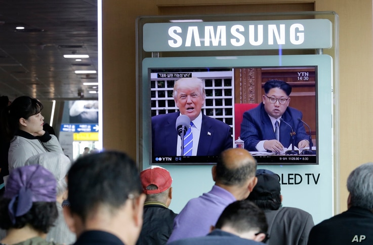 A TV screen shows images of U.S. President Donald Trump, left, and North Korean leader Kim Jong Un during a news program at the Seoul Railway Station in Seoul, South Korea, May 2, 2017.