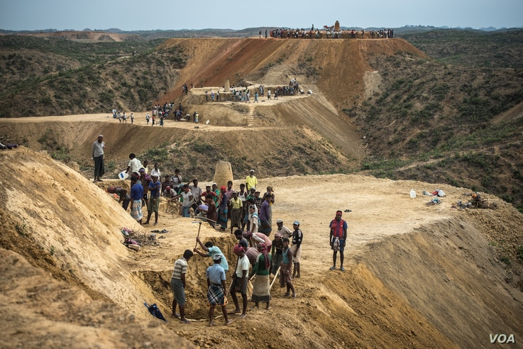 Workers flatten hillsides to make space for Rohingya refugees to move to higher ground to escape the oncoming rains in Bangladeshi refugee camps.
