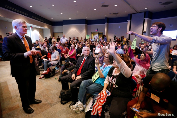 Matthew Schoenberger, of New Orleans, shouts a question at Republican U.S. Senator Bill Cassidy during a town hall meeting in Metairie, Louisiana, Feb. 22, 2017.