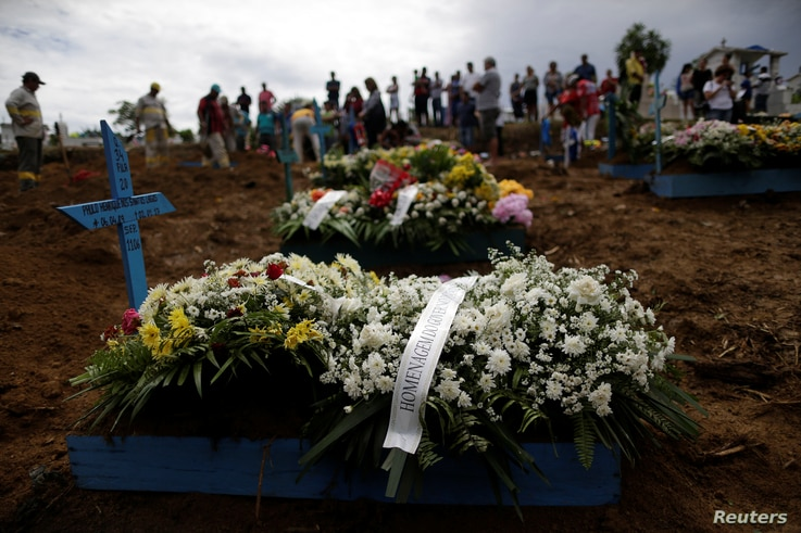 Flowers are left by relatives during the funeral of one of the inmates who died during a prison riot, at the Taruma cemetery in Manaus, Brazil, Jan. 4, 2017.