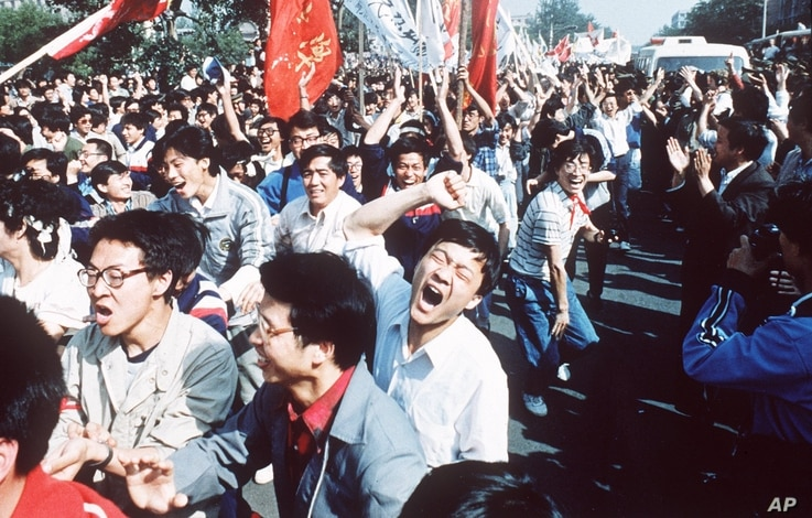 Students shout after breaking through a police blockade during a pro-democracy march to Tiananmen Square, Bejing, May 4 1989.