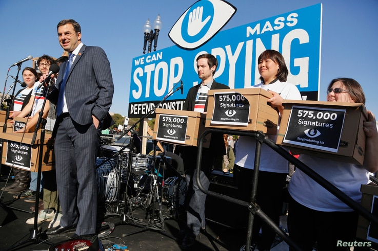 "U.S. Representative Justin Amash (R-MI) smiles as he accepts a petition organizers said represented 575,000 people calling for congressional hearings about U.S. spy programs, as he addresses the ""Stop Watching Us: A Rally Against Mass Surveillance"" ..."