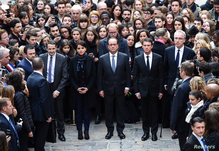 (From L) French Minister for Higher Education and Research Thierry Mandon, French Education Minister Najat Vallaud-Belkacem, French President Francois Hollande and French Prime Minister Manuel Valls observe a minute of silence at the Sorbonne Univers...