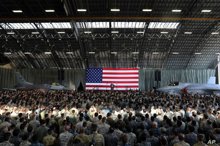 U.S. President Donald Trump delivers his speech to the U.S. military personnel and members of Japan Defense Forces upon his arrival at the U.S. Yokota Air Base on the outskirts of Tokyo, Nov. 5, 2017.