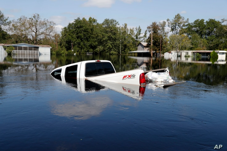 A submerged truck sits in floodwaters in the aftermath of Hurricane Florence in Nichols, S.C., Sept. 21, 2018.