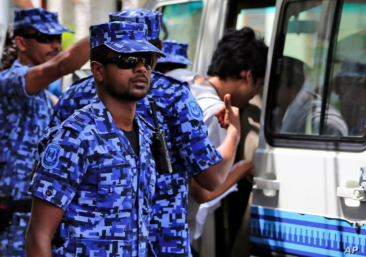 FILE  Maldivian police force guard after the arrest of Vice President Ahmed Adeeb in Male, Maldives, Oct. 24, 2015.