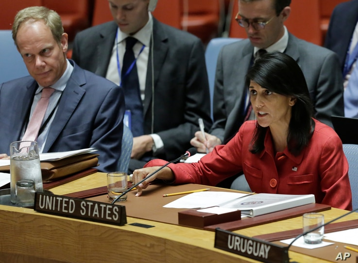 United Kingdom U.N. Ambassador Matthew Rycroft, left, listens as United States U.N. Ambassador Nikki Haley, right, respond to Russia's statements, during United Nations Security Council meeting on North Korea's latest launch of an intercontinental ba...