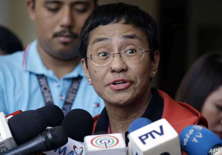 Rappler CEO and executive editor Maria Ressa talks to reporters after posting bail at the Pasig Regional Trial Court, metropolitan Manila, Philippines, March 29, 2019.