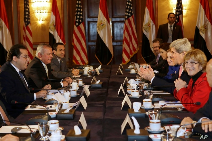 U.S. Secretary of State John Kerry, second from right, meets with members of Egyptian political parties including Ayman Nour, left, Egypt on Saturday, March 2, 2013.