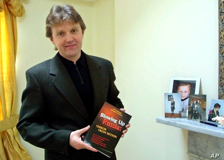 """FILE - Alexander Litvinenko, former KGB spy and author of the book """"Blowing Up Russia: Terror From Within"""" photographed at his home in London, May 10, 2002."""