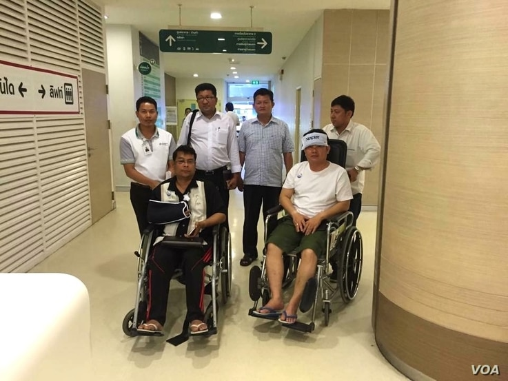 Cambodian opposition CNRP lawmakers Nhay Chamroeun and Kong Saphea are seen in wheelchairs at Phyathai hospital in Bangkok on Tuesday, October 27, 2015 after being beaten by protesters in Phnom Penh, Cambodia on Monday. (Courtesy of Nhay Chamroeun...