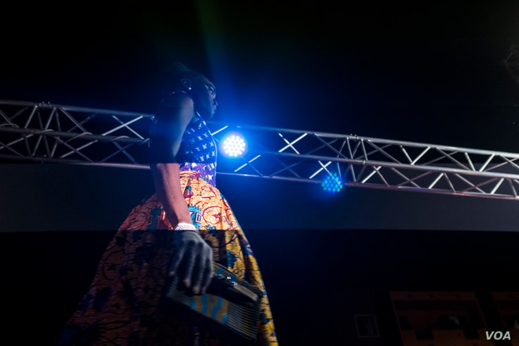 "A model walks the catwalk at Dakar Fashion Week's ""Street Parade,"" which is open to the public, June 29, 2017."
