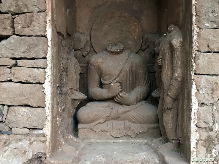 Statues are seen after being discovered and unveiled to the public, during a ceremony at the Buddhist-period archeological site near Haripur, in Khyber Pakhtunkhwa (KPK) province, Pakistan, Nov. 15, 2017.