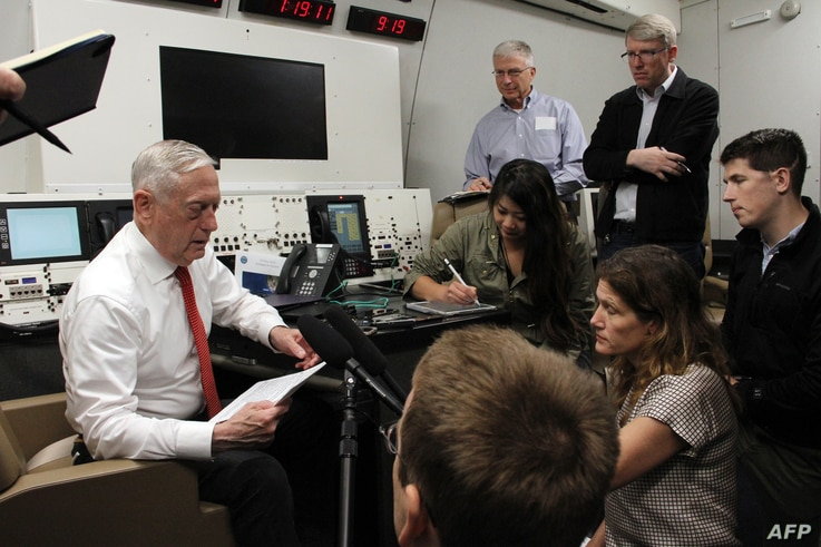 Defense Secretary Jim Mattis speaks to reporters aboard a US military plane on May 29, 2018, as he flies to Hawaii.