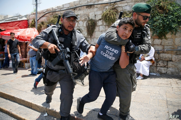 Israeli border guards detain a Palestinian youth during a demonstration outside the Lions Gate, a main entrance to Al-Aqsa mosque compound, due to newly-implemented security measures by Israeli authorities which include metal detectors and cameras, i...
