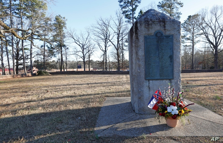 A memorial marker stands in the University of Mississippi campus cemetery that has the graves of Confederate soldiers killed at the Battle of Shiloh, March 5, 2019. The Associated Student Body Senate voted 47-0 Tuesday night, for a resolution asking ...