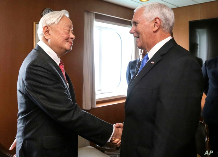 In this photo released by Taiwan's Ministry of Foreign Affairs, Taiwan's special APEC envoy Morris Chang, left, meets with U.S. Vice President Mike Pence on the Pacific Explorer cruise ship on the sidelines of the APEC Summit, Nov. 17, 2018, in Port ...