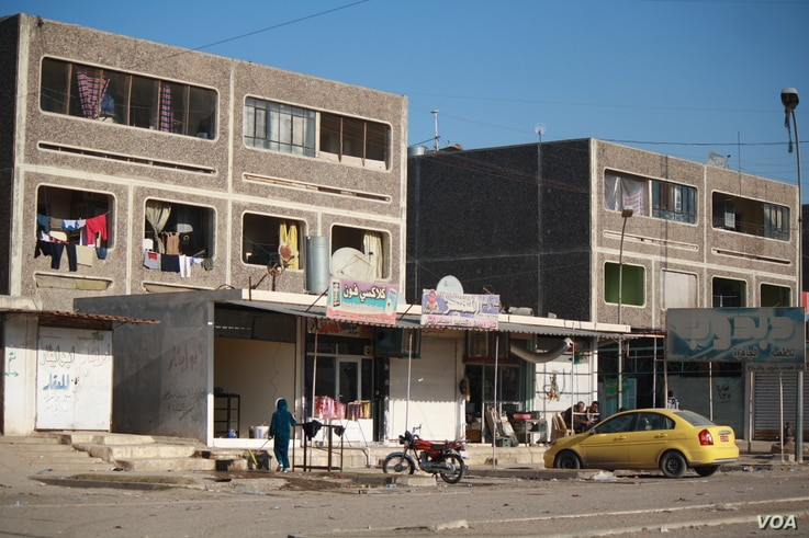 A photo shows a square of shops in The Apartments where militants stoned a young woman, according to residents, as they ramped up harsh punishments in the months before they were defeated, in Mosul, Iraq, Feb. 8, 2017. (H.Murdock/VOA)