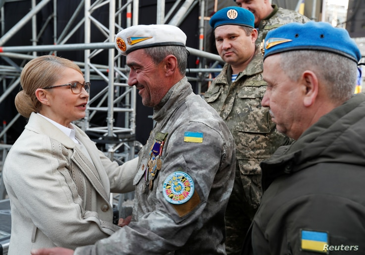 Presidential candidate Yulia Tymoshenko is greeted by soldiers during her last campaign rally in central Kyiv, Ukraine, March 29, 2019.