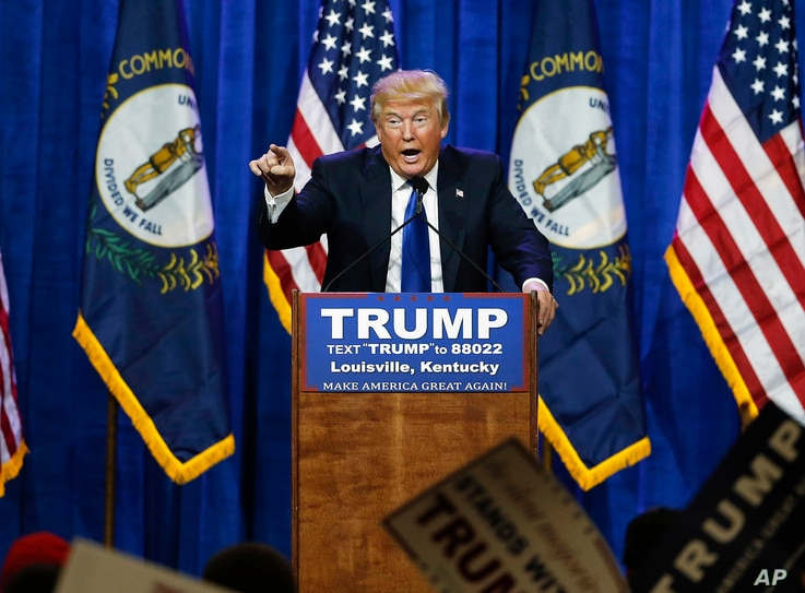 FILE - Republican presidential candidate Donald Trump speaks during a rally in Louisville, Ky., March 1, 2016. On Friday, a federal judge rejected Trump's free speech defense against a lawsuit accusing him of inciting violence against protesters d...